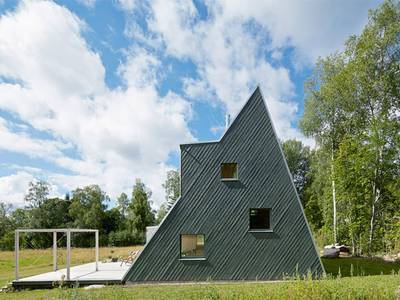"""Summer home built with salvaged materials is a """"treehouse for adults"""" 1"""